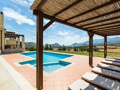 Rethymno villa rental - The pool terrace is equipped with sun beds, under the shade of a pergola!