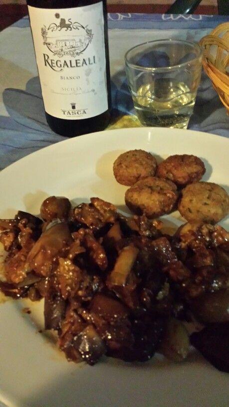 Ustica's food: aubergine caponata, fishball and white sicilian wine.  Bella vita!