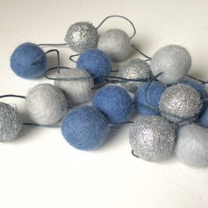 Winston + Grace – Blue Grey Glitter Felt ball Garland These beautiful 2 metre felt ball garlands can be hung or draped in any area of the home and are perfect for kids rooms and grown up spaces alike! There are no knots in the felt ball garlands meaning you can style them as you please (the felt balls will stay in place even without the knots!)  The felt ball garlands are 100% handmade by us using NZ wool felt balls sourced from Nepal which are certified fair trade, free from chemicals and…