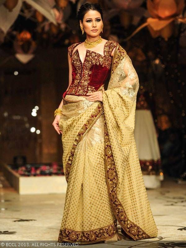 Shruti Agarwal showcases a creation by designer Rohit Bal during the grand finale of India Bridal Fashion Week '13, held at Grand Hyatt, in Mumbai.