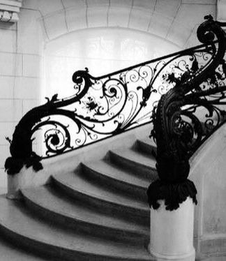 Art Nouveau Staircase using vines and flowers making it look highly decorative and doesn't look completely finished off.