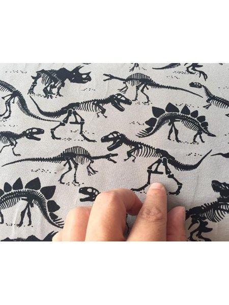 Bomuldsjersey - sart grå med skeletter af dinoer