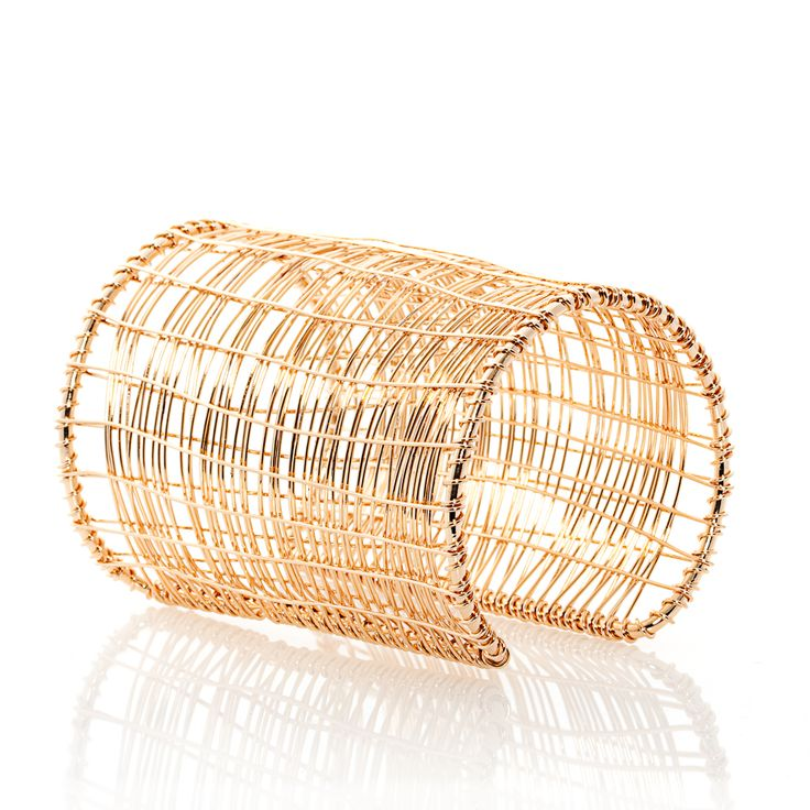 Complete your weekend outfit with this very defined wide wire cuff. With its grid like design which gives it a lighter feel wear it casually or on a night out. Match it with a pair of gold earrings to seal this simplistic yet bold look.
