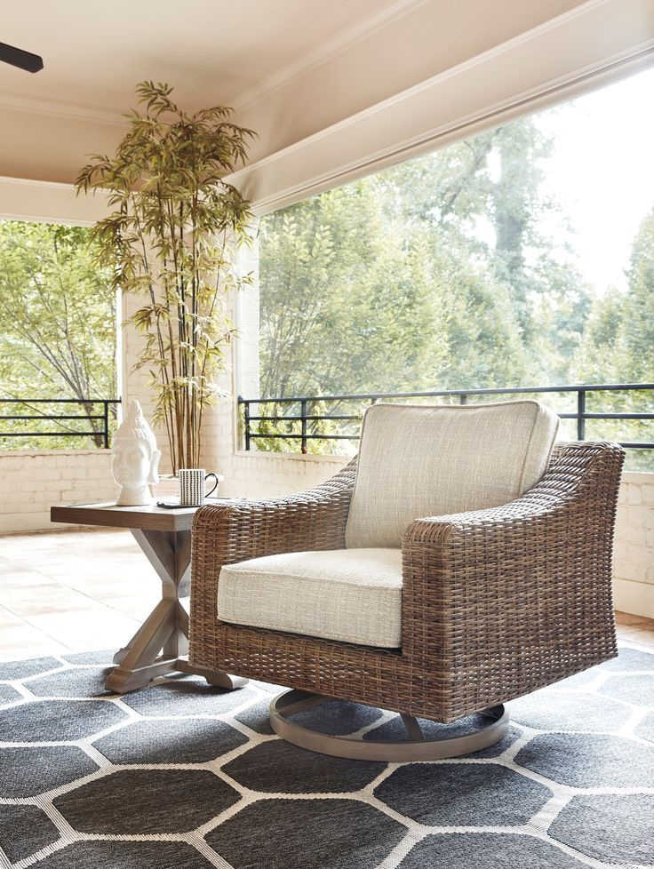 Beachcroft Swivel Lounge Chair with Cushion by Benchcraft ... on Beachcroft Beige Outdoor Living Room Set  id=30771