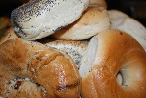 Bagels are made with refined flours which are not healthy. Plus, they are significantly more dense than bread, which means eating one bagel is equivalent to eating 5 slices of bread when it comes to calories & carbohydrates. Also, most people top their bagels with  cream cheese which contains a lot of fat. Instead, eat wholegrain bread with natural jelly & butter. Breakfast should also include a good source of protein which you can get by adding eggs or yogurt.
