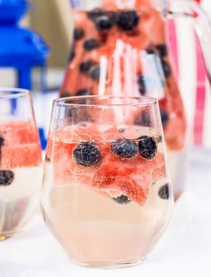 Recipe: 4th of July Wine Sparklers | Fourth of July recipes can be so fussy, but these perky blueberries and star-shaped slices of watermelon bob festively in the drink, transforming the spritzer into a holiday-appropriate sparkler. They also make for tasty edible garnishes to gobble up once you're done sipping.