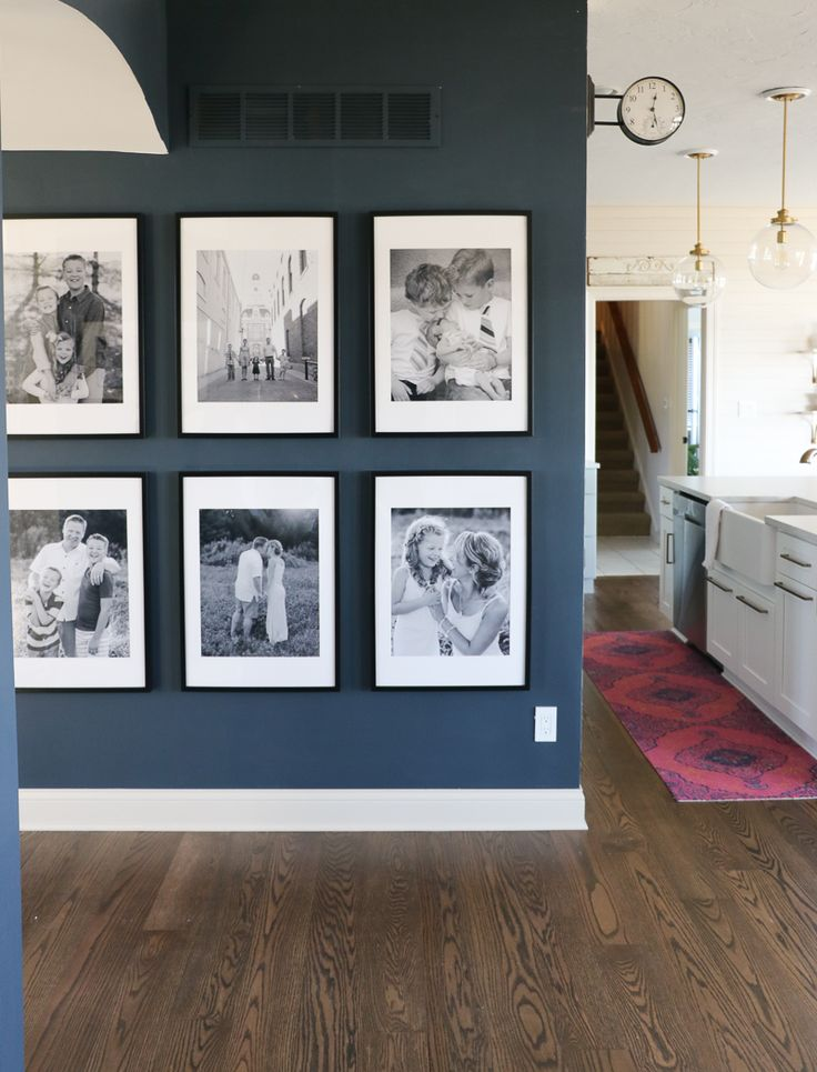 Easy & Inexpensive Large Photo Gallery Wall - love the dark moody wall!