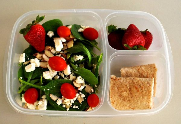 Spinach salad with feta cheese, almonds, grape tomatoes. Strawberries, turkey and cheese rolled in a whole wheat flour tortilla