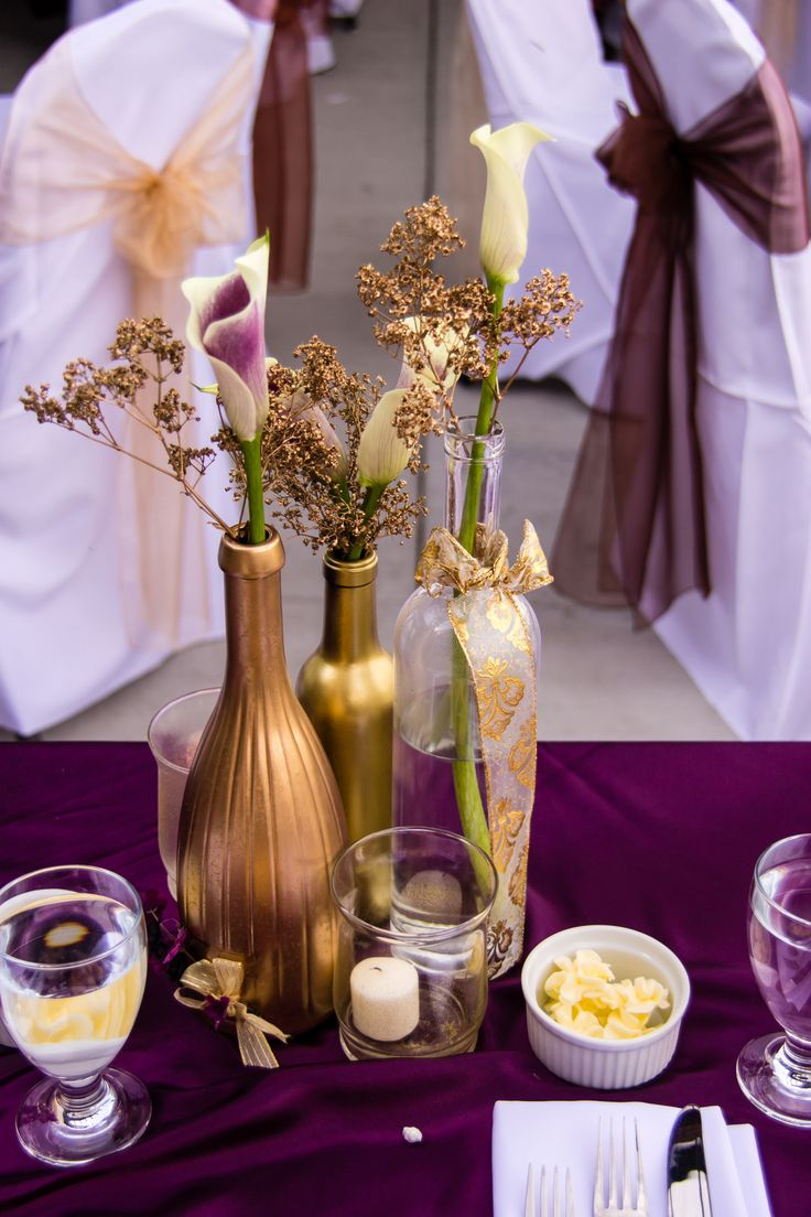 Plum, gold  bronze wedding colors. Credit: Megan Élan Photography