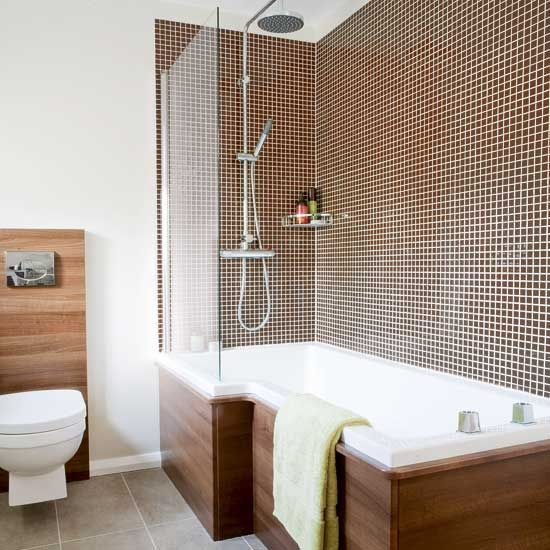 wood detail around tub and behind toilet