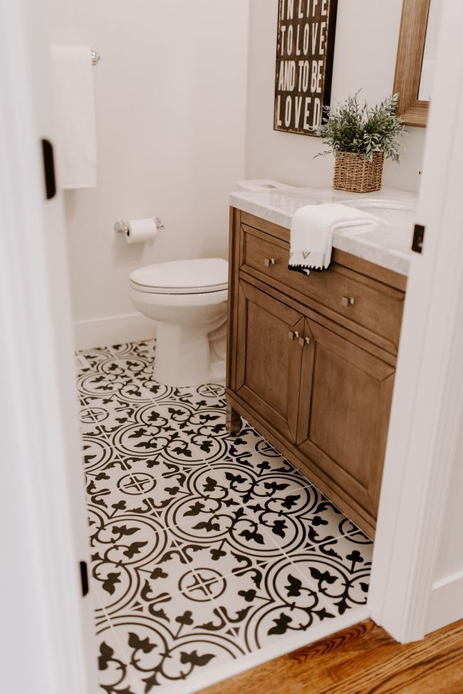 Black and white tiles with a walnut vanity are perfection in this modern farmhouse style renovation.