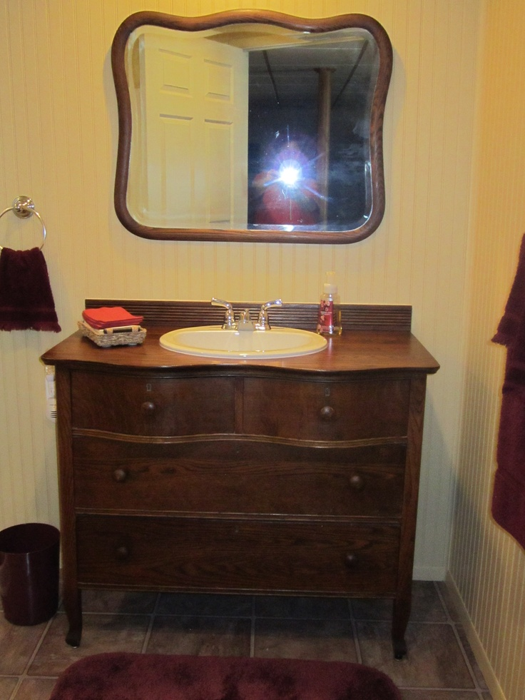 old dresser made into vanity for only  50 cost of sink and