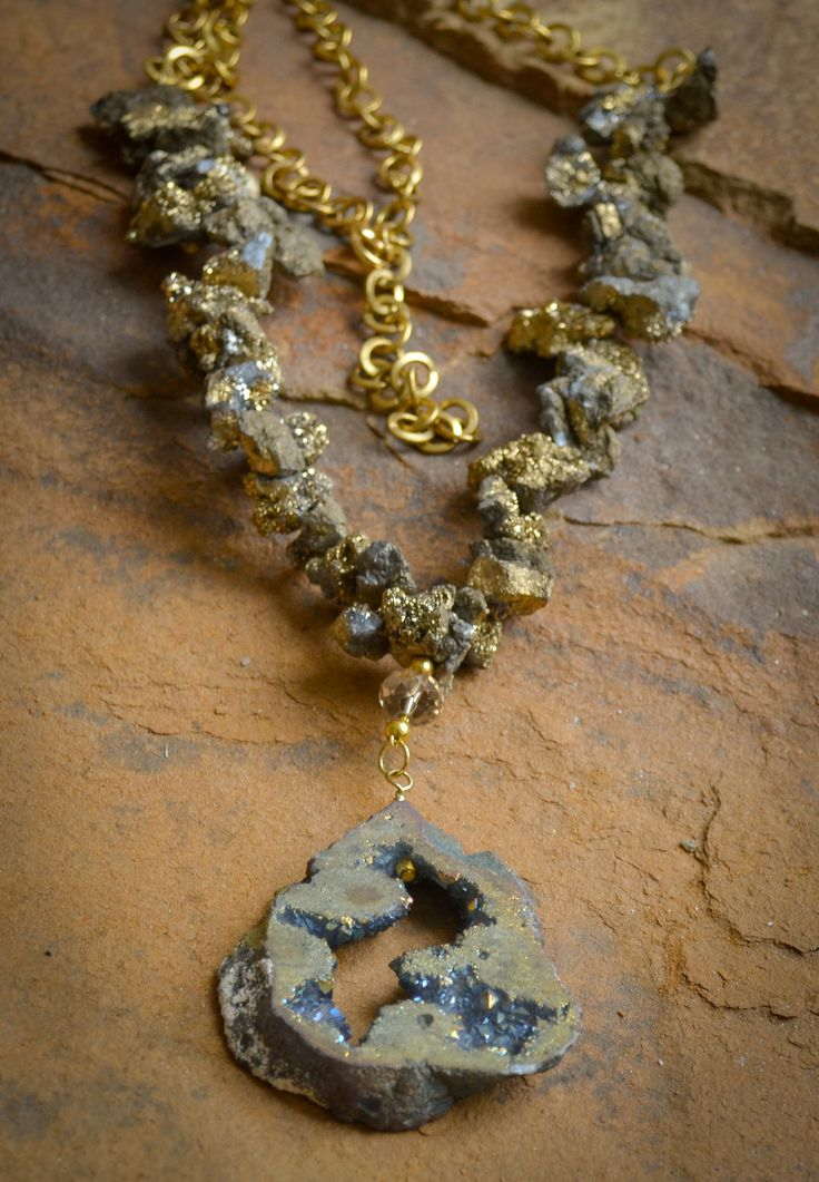 """Chunky druzy nuggets, gold beads and chain with large druzy pendant. Necklace is 32"""" in length with a 3"""" extender. Customization available upon request. Stone shape and size may vary."""