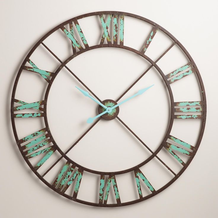 A bold statement piece for the kitchen or living room, our oversized iron clock is finished in black with vintage brown and aqua distressing for architectural salvage appeal. >> #WorldMarket New Year's Entertaining