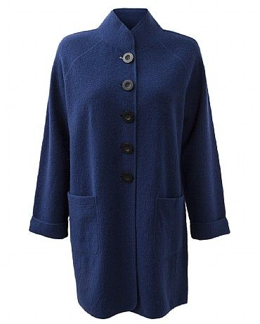 Boiled Wool Funnel Coat Finish off your look with our Funnel Neck Boiled Wool Coat. Featuring big functional pockets and bold buttons, this coat with keep you warm while adding a touch a boldness to your outfit. Our deepblue colorway is designed to brighten up your Winter wardrobe, team with our colour cords and our Brady Swing Jumper for a modern chic look.