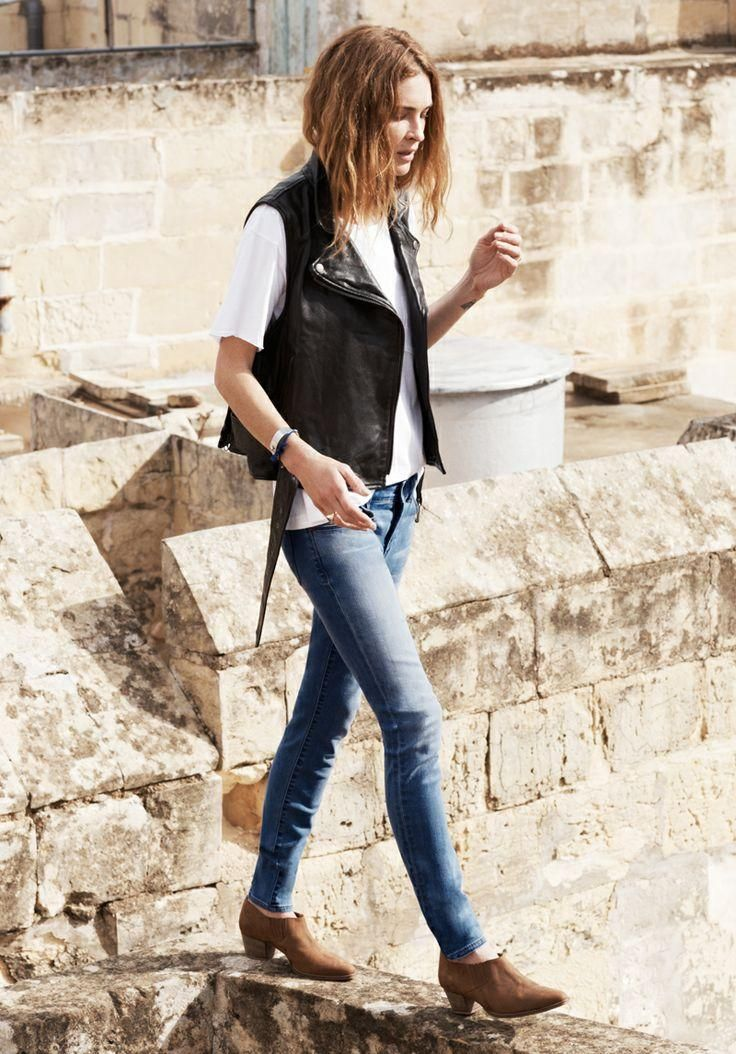 Leather vest and jeans.