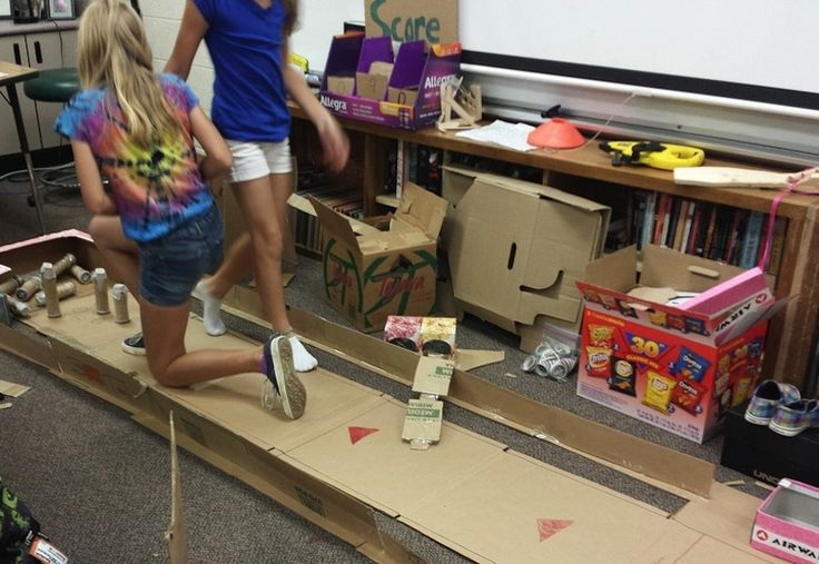 Girls work on their bowling alley. The pins are made out of cardboard, Starbucks lids and egg cartons. (Photo c/o Michael Buist)