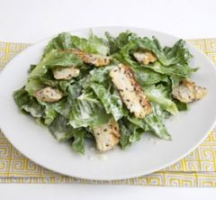 Grilled Tempeh 'Caesar' Salad - This isn't a real Caesar salad; no eggs or anchovies are used. Silken tofu and capers make a creamy, tangy vinaigrette that you can prepare ahead of time. Tempeh is a fermented soy product that is used in Indonesian cooking. Tempeh always needs to be cooked before using. I like it best broiled. It has a meaty texture that goes well in stir-fries and curries. For this salad, it will replace the chicken breast that is so often used to bulk this dish up into a…