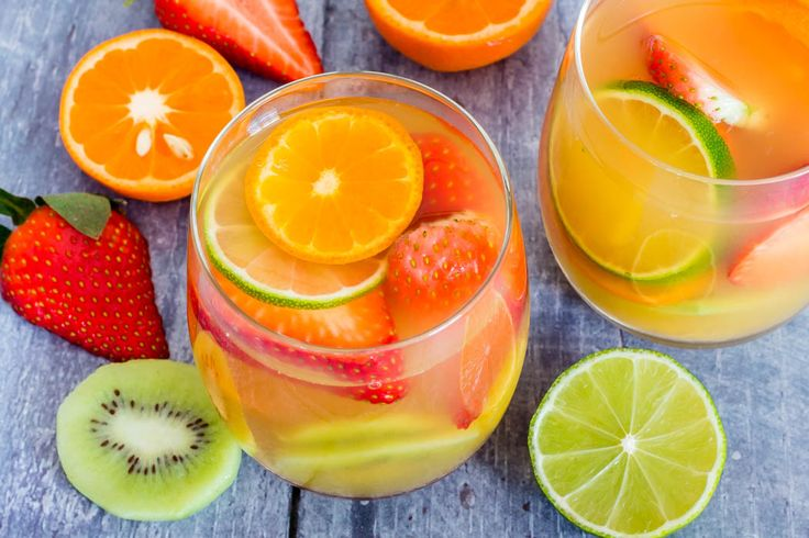 Here is an easy five ingredients tropical white wine sangria recipe made with white wine, pineapple juice, passionfruit juice, dark rum and tropical fruits. | www.recipesfromapantry.com