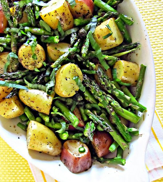 Roasted New Potatoes and Asparagus-- Except I would add asparagus with about 15-mins. left.....