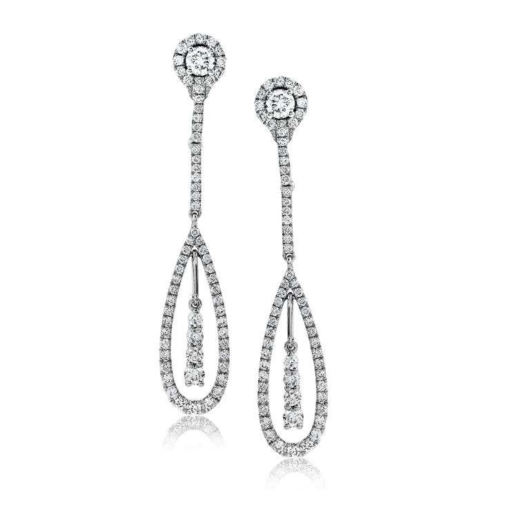 Presenting a dainty teardrop style, these classic white gold earrings are highli...