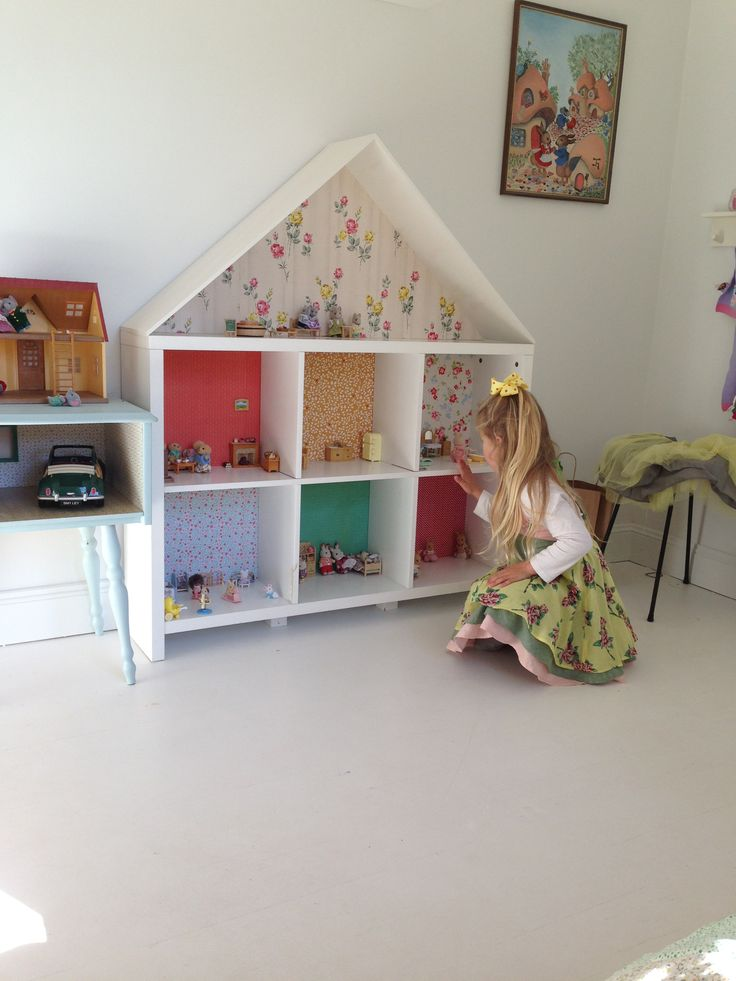 DIY dolls house grows with you to be a stuff animal house to a book case