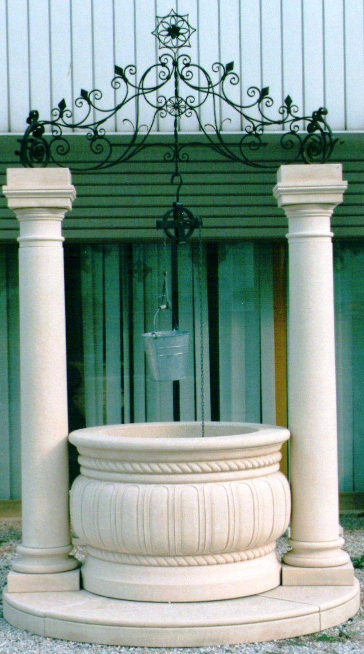wellhead with columns and iron top element - in italian Vicenza limestone - design by Garden Ornaments Stone srl - www.gardenorn.com