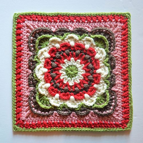 """This 12"""" afghan square uses puff stitches and back post stitches to create an array of fan shapes. Bright contrasting colors make the fans appear to move and dance around each other. Or, try a single color to bring out the rich texture created by the post stitches."""