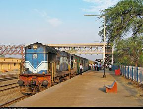Secunderabad bound superfast Shatabdi express with re-built WDM-3A loco, waits for the crossing of Chennai-Mumbai express at a small station, Bhigvan. Assistant Loco-Pilot is on routine check-up.
