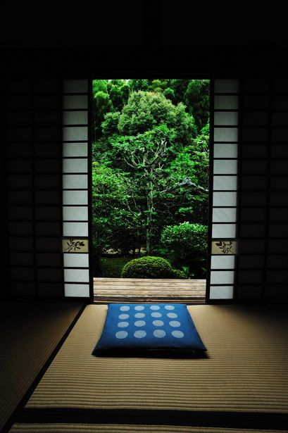 Tatami room with a garden view.