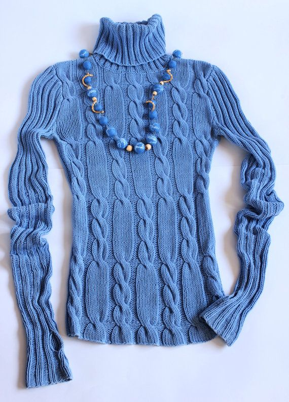Blue knitted sweater and mittens