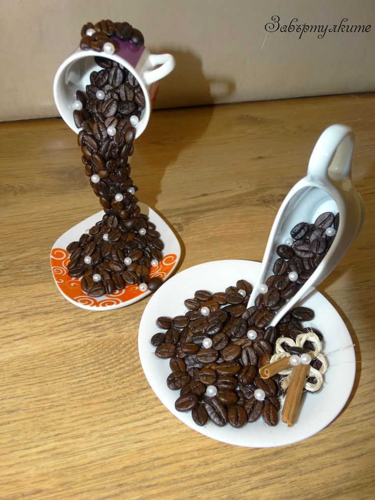 Flying cups with coffee, cinammon and pearls