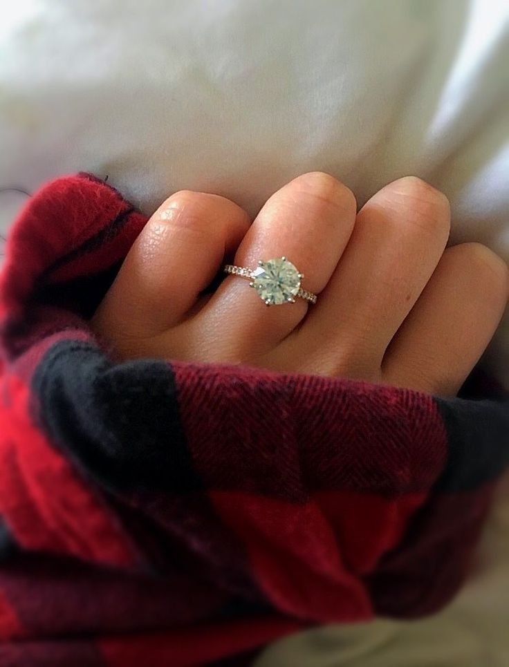 Classic solitaire engagement ring with a thin pave band! This is any girl's dream.