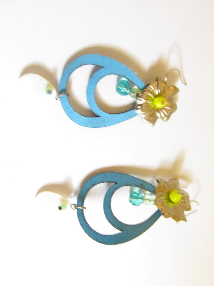 Handmade laser cut leather earrings (1 pair)  Made with turquoise leather filigree, metal flower silver tone, mother of pearl teardrop and glass beads.