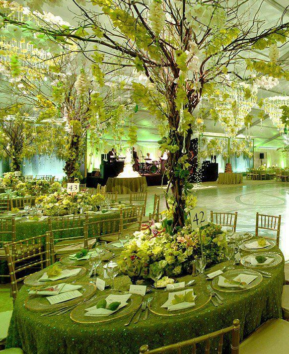 MEN'S VOWS: If green is your color, we say go for broke! We like the use of green lighting to help create the feeling of an enchanted forest.