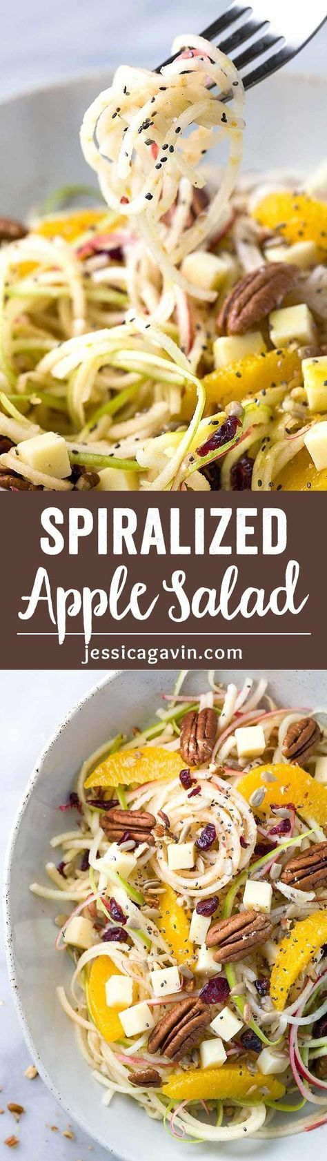 Spiralized Apple Salad with Citrus Dressing - Healthy and refreshing recipe made in only 15 minutes! Topped with oranges, pecans, cheddar cheese, cranberries, sunflower and chia seeds.
