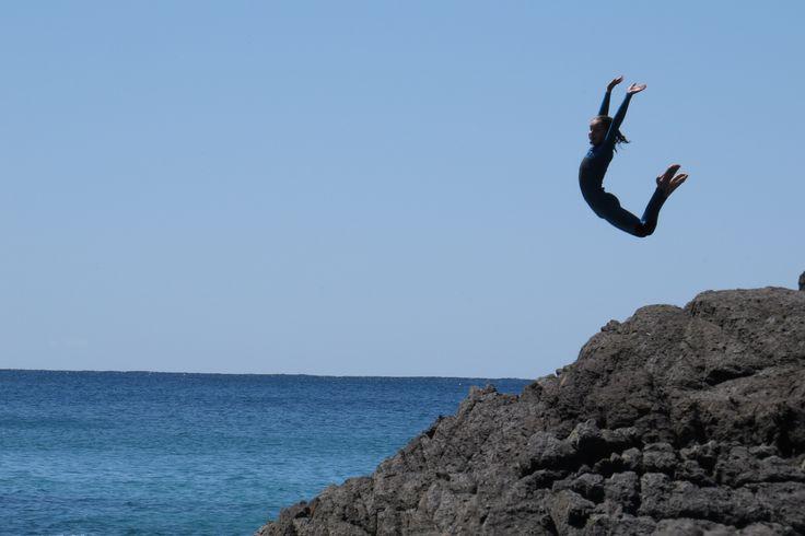 jumping off the rocks at Seal Rocks, NSW, Australia