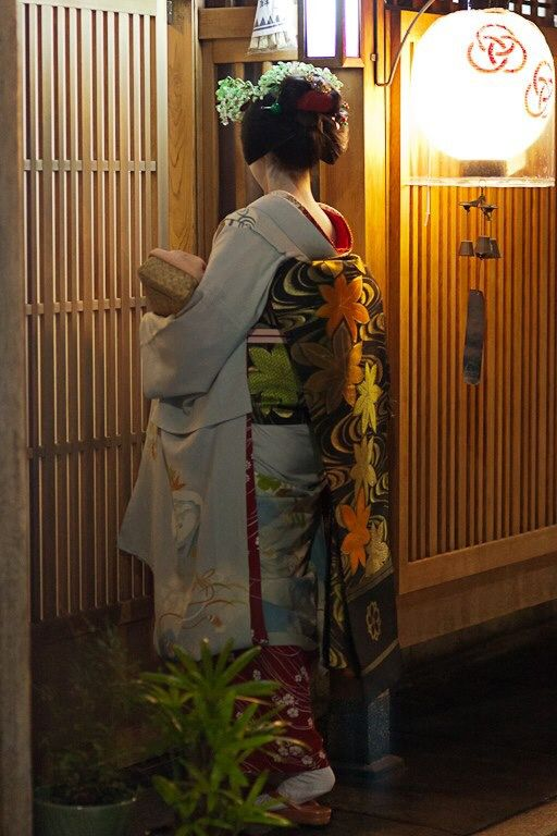 "Japan - Maiko entering ""chaya"" (tea house) for an evening appointment."