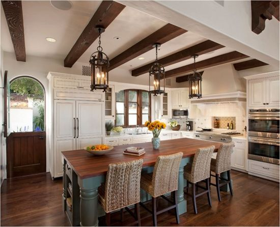 Design ideas for a mediterranean open concept kitchen in Santa Barbara with shaker cabinets, medium tone wood cabinets, wood countertops and terra-cotta floors. Description from houzz.com. I searched for this on bing.com/images