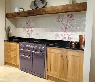 Featured here in Purple Haze, this Mercury range cooker looks stunning in this Baker and Baker showroom teamed with their oak Shaker display and contemporary floral detailed tiles.