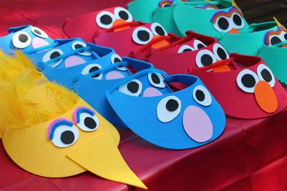 Sesame Street Visors... Love big birds seed search, the backdrop for pictures, etc... really cute ideas.