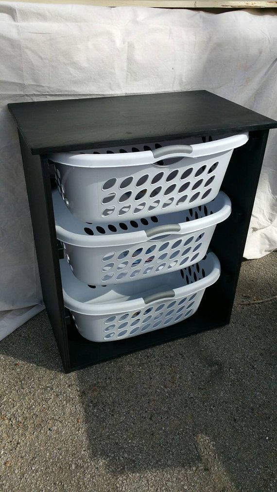 This listing is for a gorgeous handcrafted solid wood black laundry basket bin holder. Great to hide the mess that sometimes laundry can be.