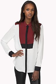 Eye-catching silk blouse in a colour-blocked and bib-inspired design. Small collar, contrasting and hidden placket. Tommy Hilfiger tag above the straight bottom hem.<br/><br/>Our model is 1.76m and is wearing a size S Tommy Hilfiger blouse.