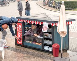 Coca-cola mini kiosks by ogilvy & mather berlin promote tiny coke cans