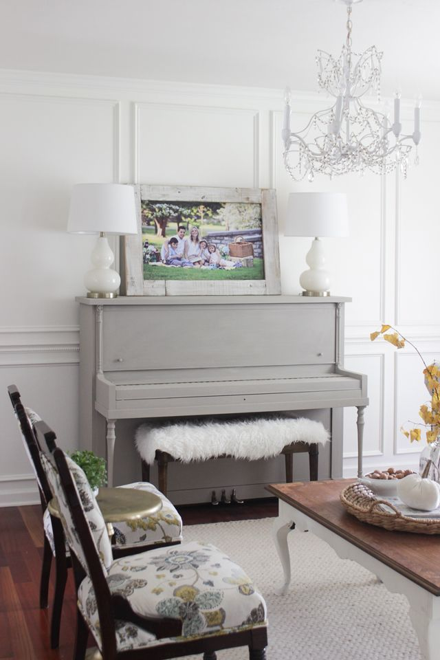 Painted gray vintage piano in formal front room
