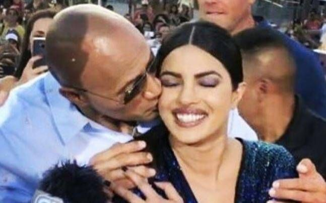 WATCH: Dwayne Johnson plants surprise kiss on Priyanka Chopra at Baywatch premiere : Celebrities, News - India Today http://indiatoday.intoday.in/story/priyanka-chopra-dwayne-johnson-kiss-baywatch-miami-premiere/1/954116.html?utm_campaign=crowdfire&utm_content=crowdfire&utm_medium=social&utm_source=pinterest