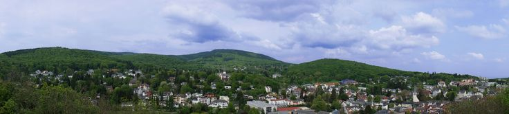 https://flic.kr/p/nmjz5E | Königstein panorama | Königstein im Taunus landscape panorama, a view out over Germany from the battlements of the mighty ruined fortress Burg Königstein. Looking toward the high hills of the Taunus mountains. Hesse, Germany. Sony Nex3