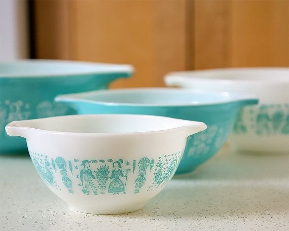 A Smart Hostess knows that cookies taste better when they are made with love. Its easy to love your cookie dough when you mix it in this charming set of vintage 1950s turquoise and white Pyrex Amish Butterprint Cinderella mixing bowls. This pattern was introduced in 1957.  This 4-piece bowl set is in excellent condition, no chips or cracks. The paint on the outside of each bowl looks nice, bright, and shiny with no paint loss; the largest bowl has some very minor scratches from light use…
