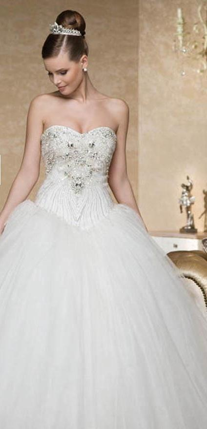 New To Gowns Of Elegance