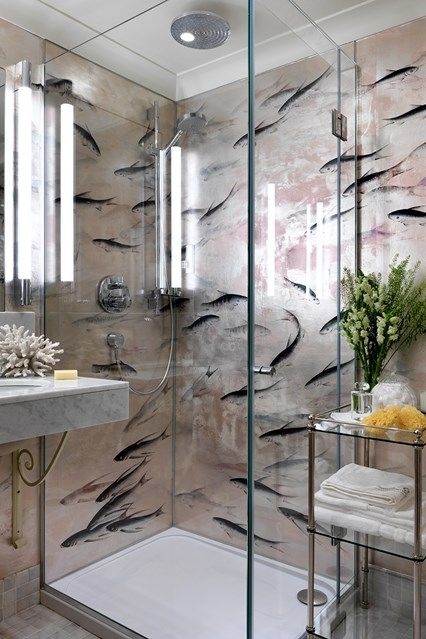 Bathroom with glass shower cubicle and patterned fish wallpaper in a small flat with antique furniture & patterned wallpaper. HOUSE - design, food and travel by House & Garden.